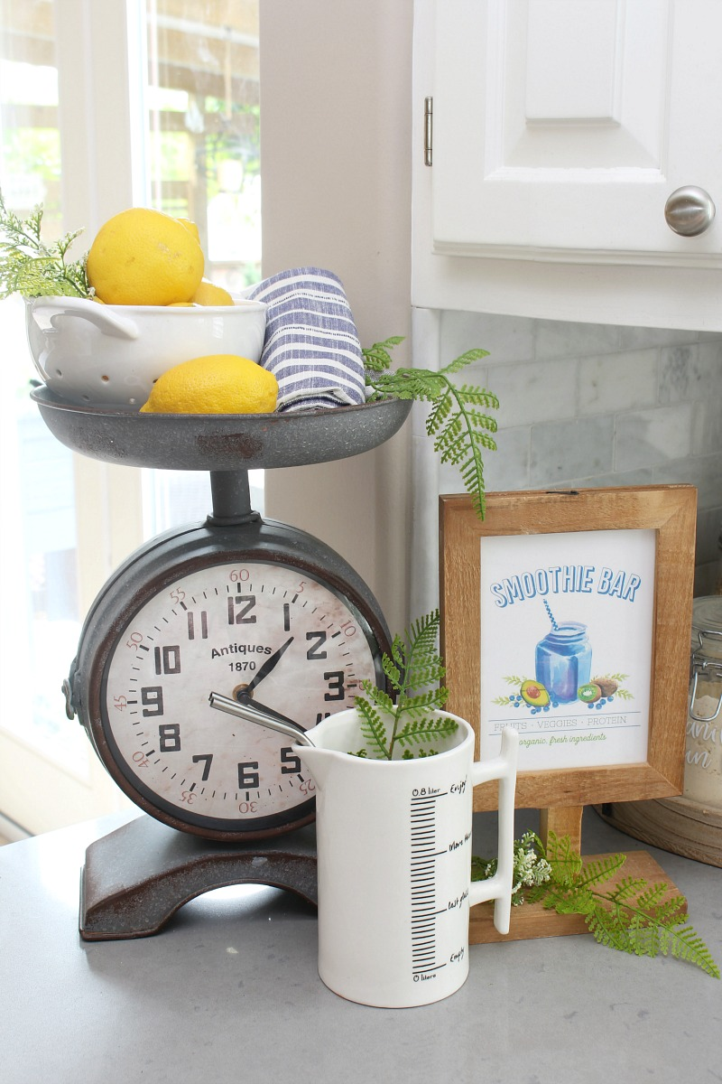 Summer vignette with vintage inspired scale clock.