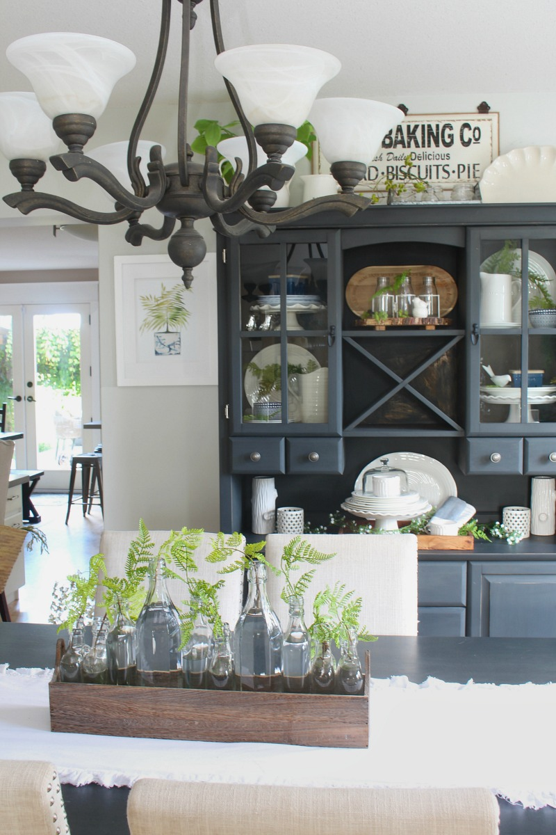 Farmhouse style dining room decorated for summer with blues and greens.