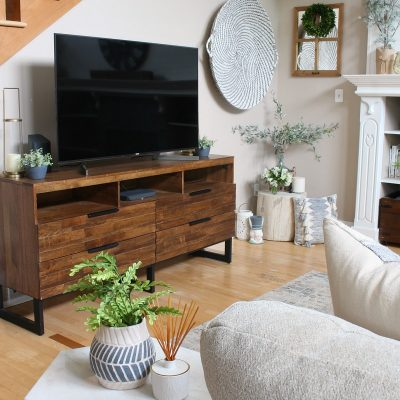Modern farmhouse style family room with wood television console.