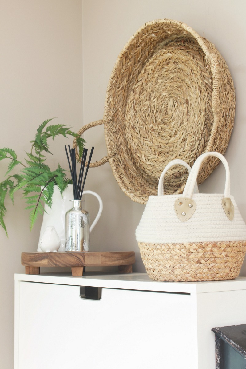 LIght and airy front entryway with woven baskets.