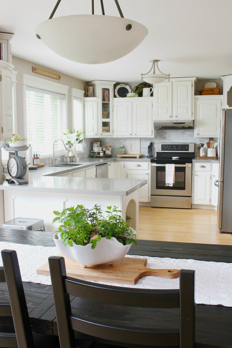 White farmhouse style kitchen decorated for summer.