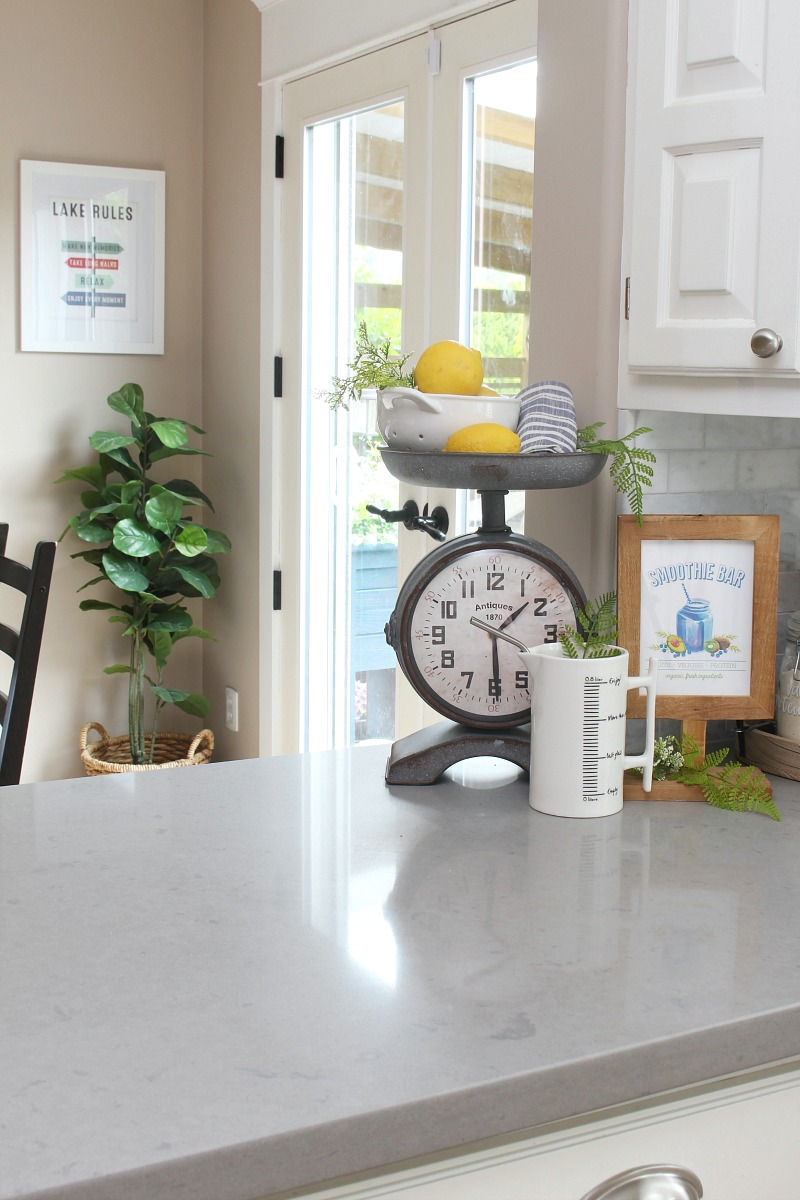 Farmhouse style kitchen with vintage inspired scale clock.