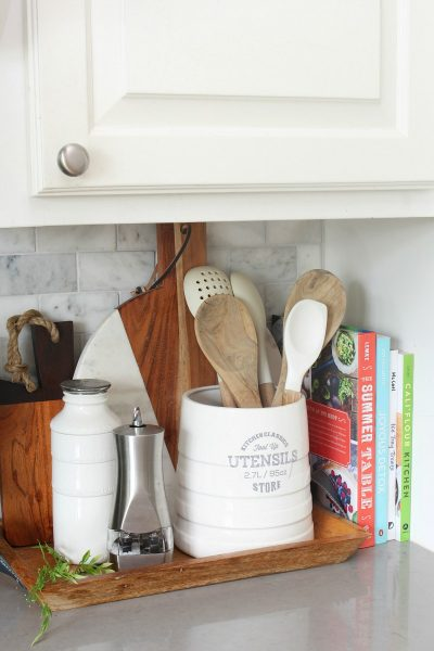 Wood tray used to corral kitchen essentials.