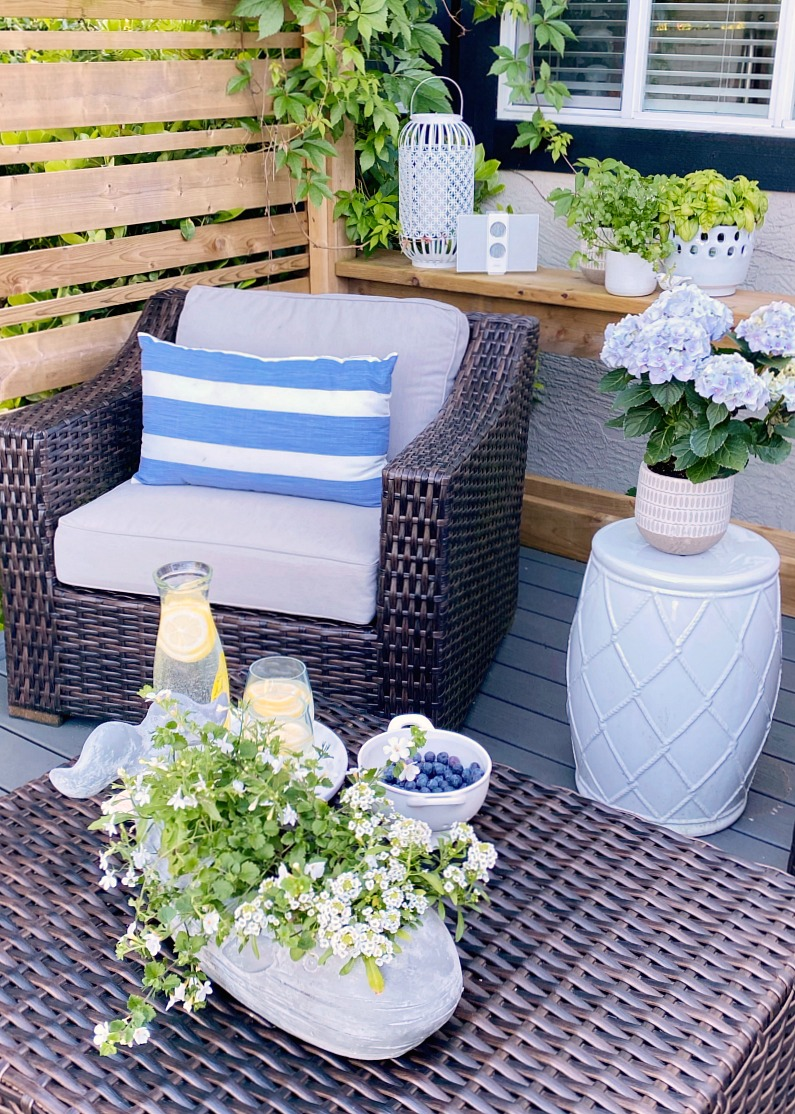 Outdoor club house chair with blue and white striped pillow..