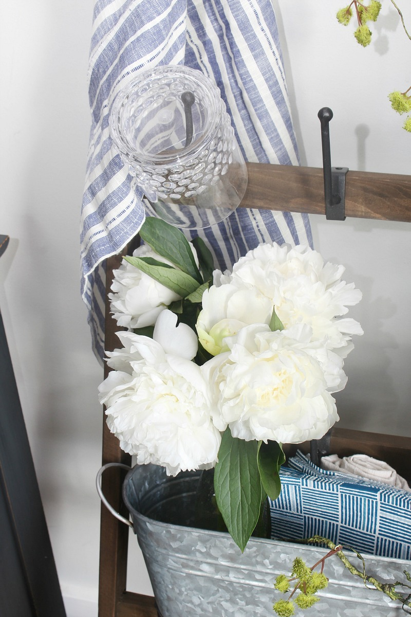 White peonies in a mason jar for easy summer decor.