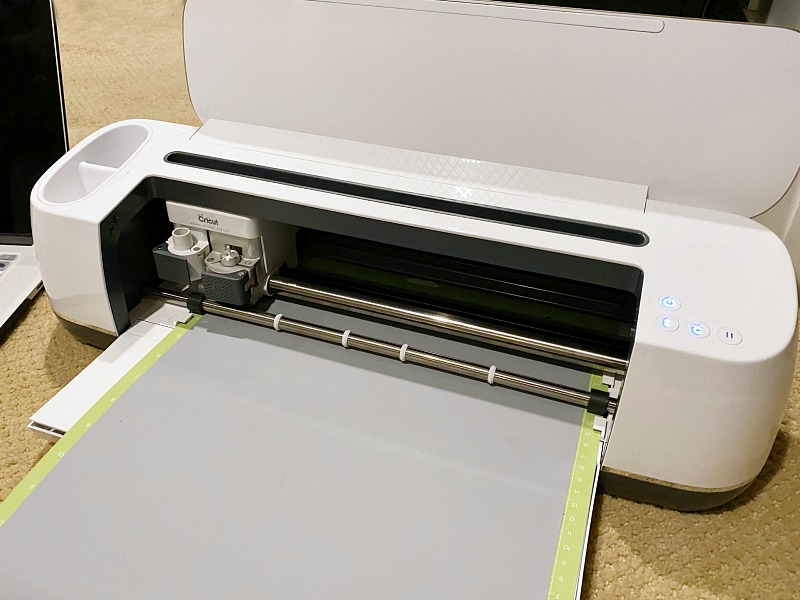 Cricut Maker cutting machine cutting iron-on vinyl.