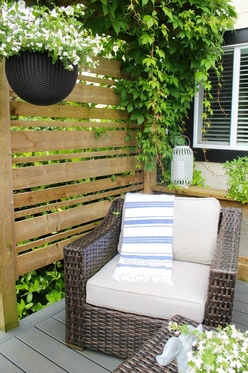 Blue and white striped DIY custom beach towel on a patio club chair.