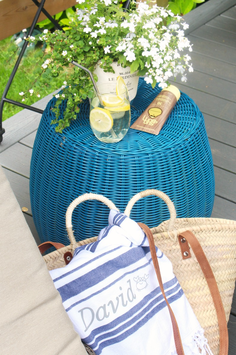 Blue and white striped custom beach towel in a beach tote.