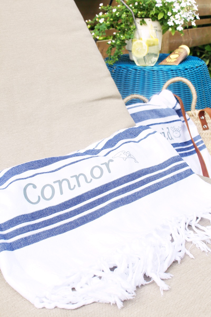 Blus and white striped DIY custom beach towel on a patio lounger