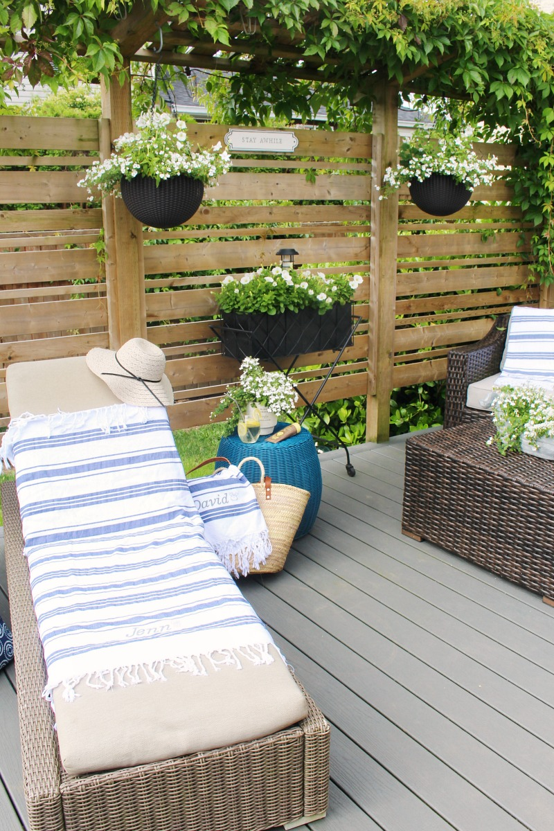 Summer patio with DIY custom beach towels for lounger and chairs.