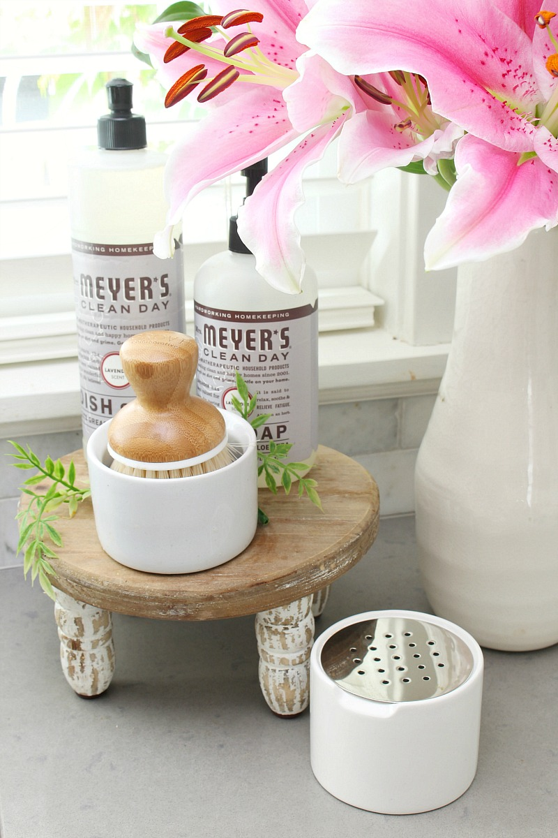 DIY fruit fly trap to get rid of fruit flies sitting beside kitchen sink.