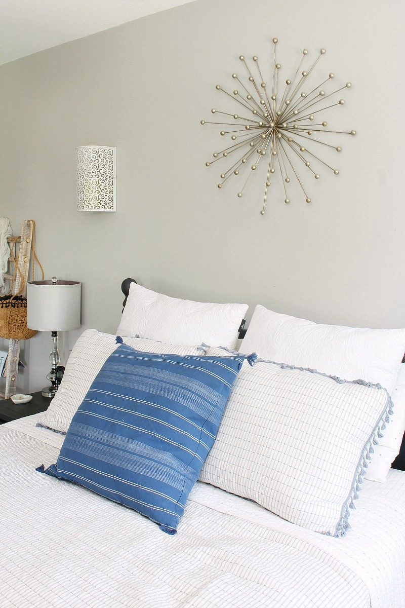 Light and airy summer bedding and throw pillows.