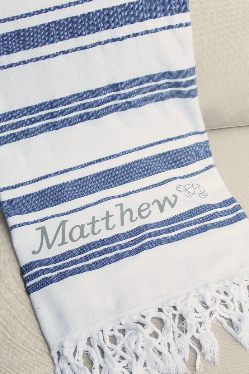 Blue and white striped towels with DIY custom name using iron-on vinyl.