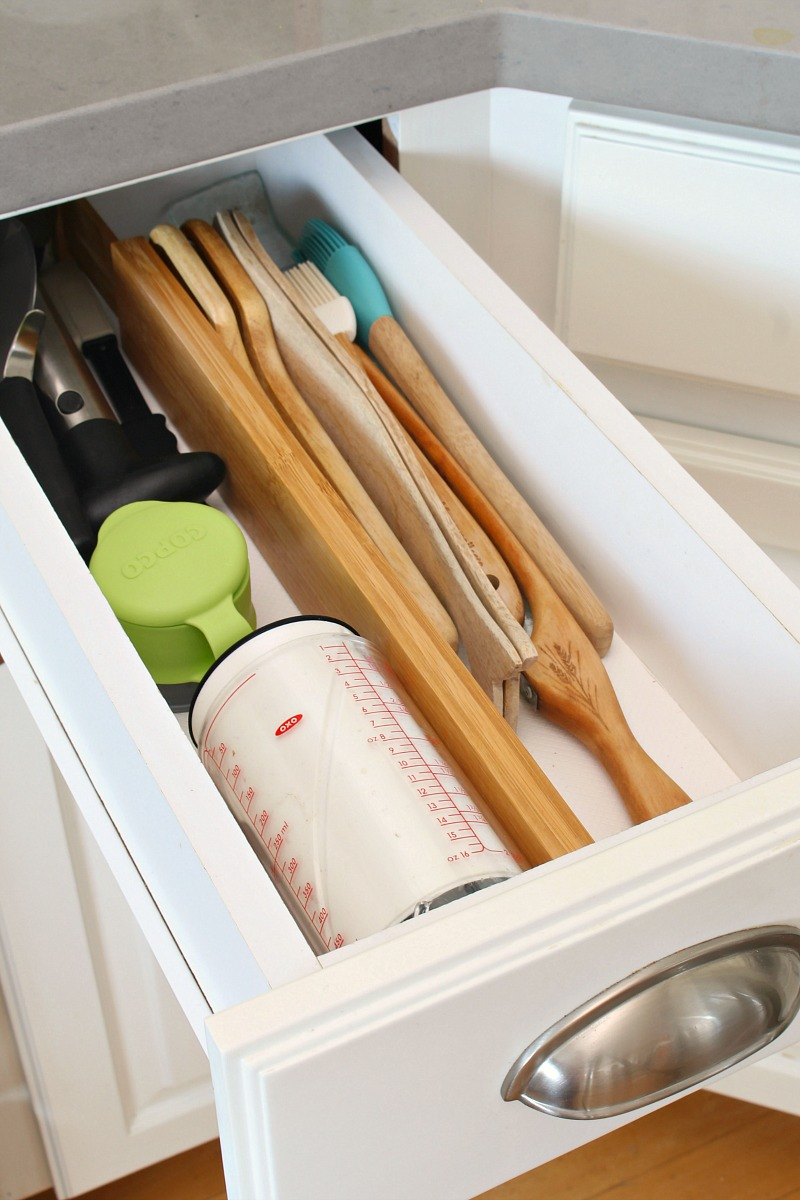 Organized utensil kitchen drawer with drawer divider.