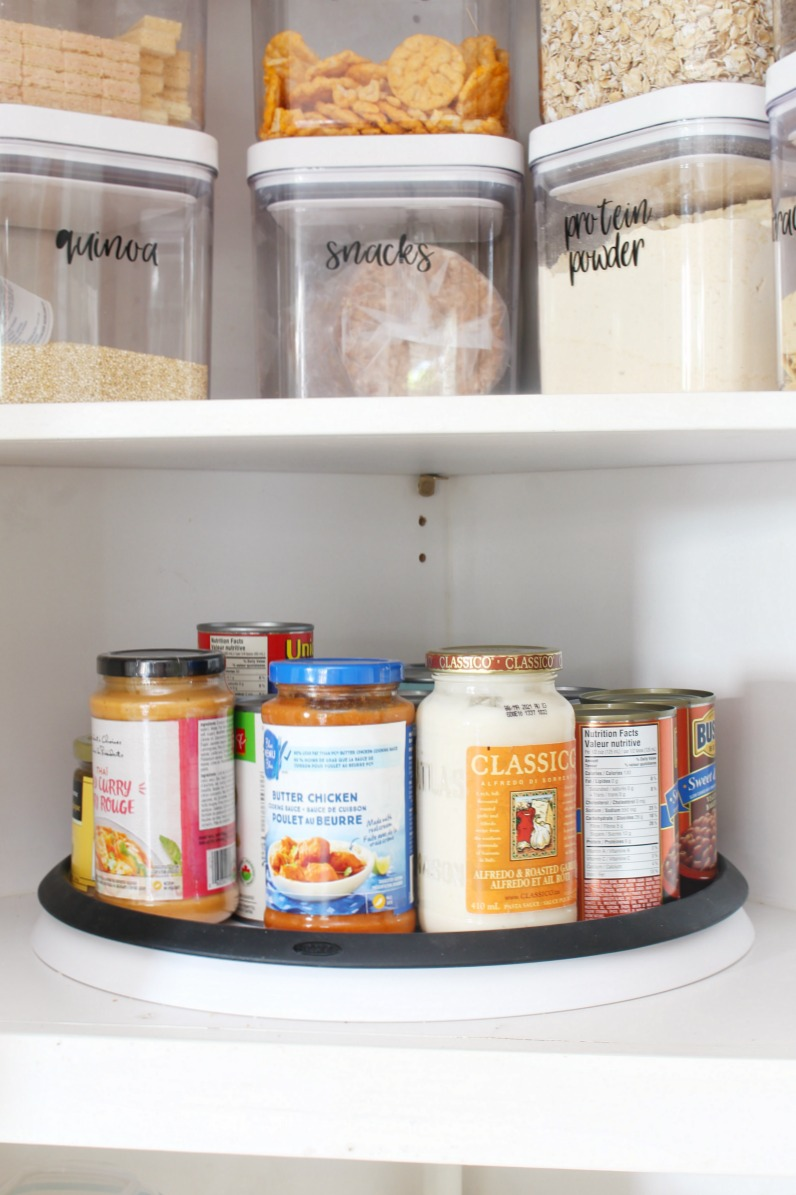 Organized kitchen pantry cabinet with lazy susan.