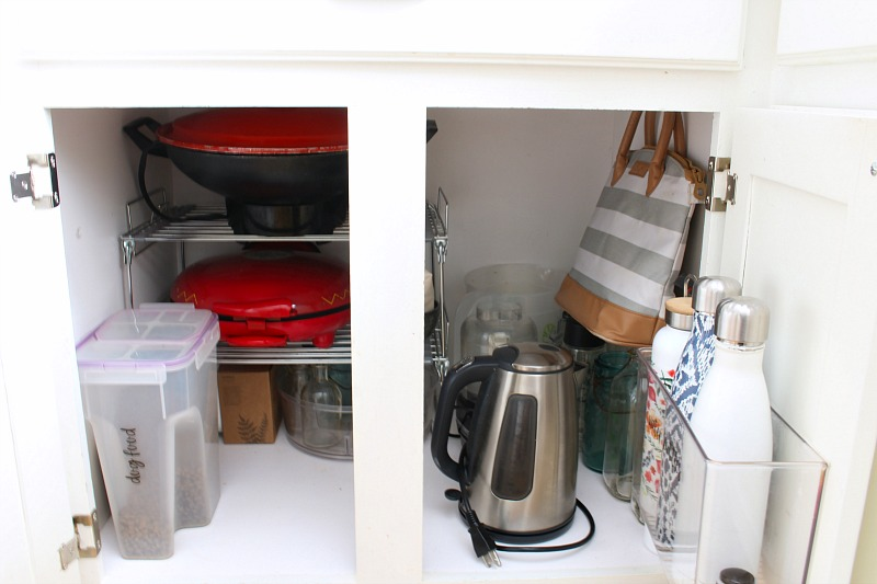 Organized kitchen cabinet with wire storage rack.