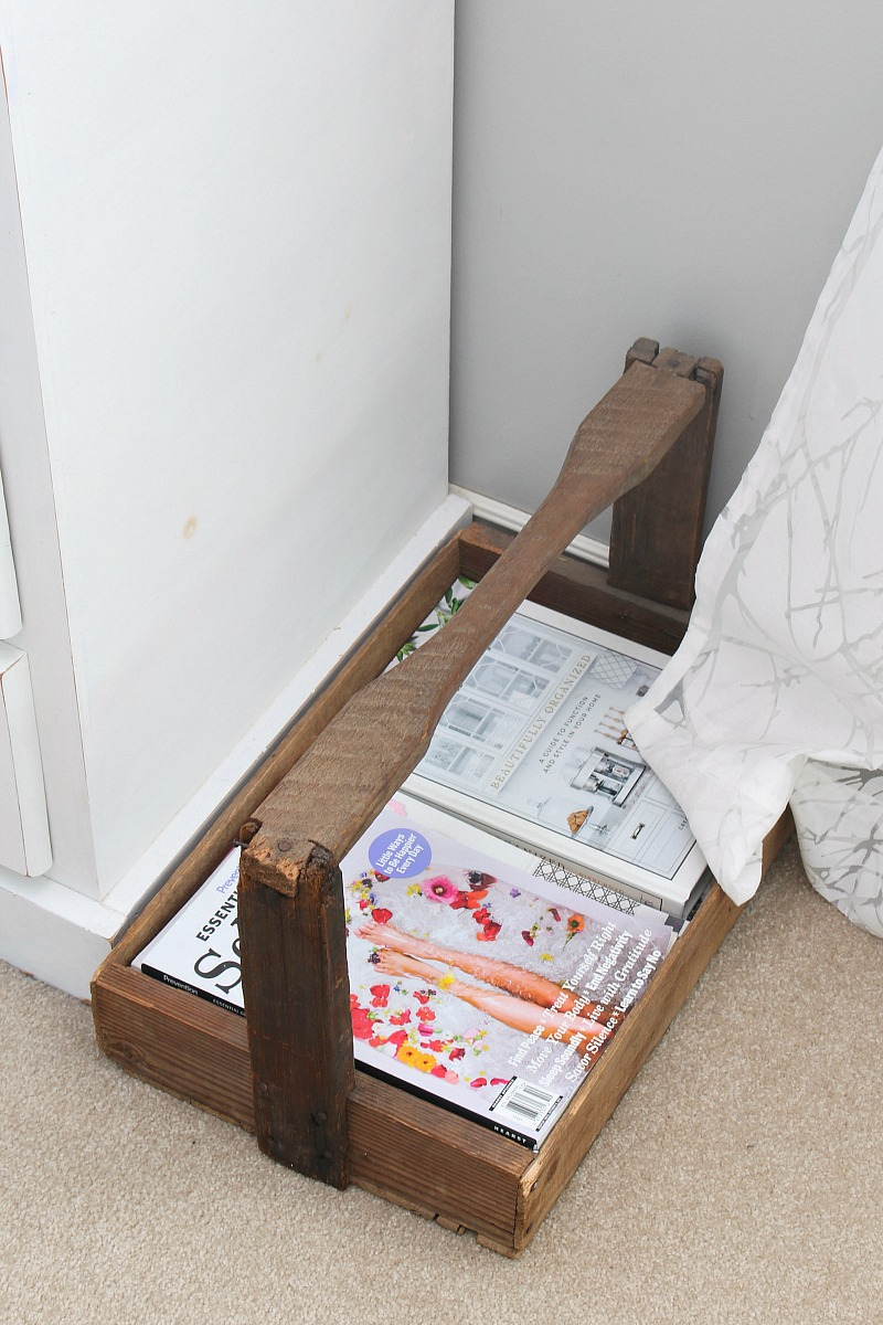 Wood tray with handle used to store books and magazines.