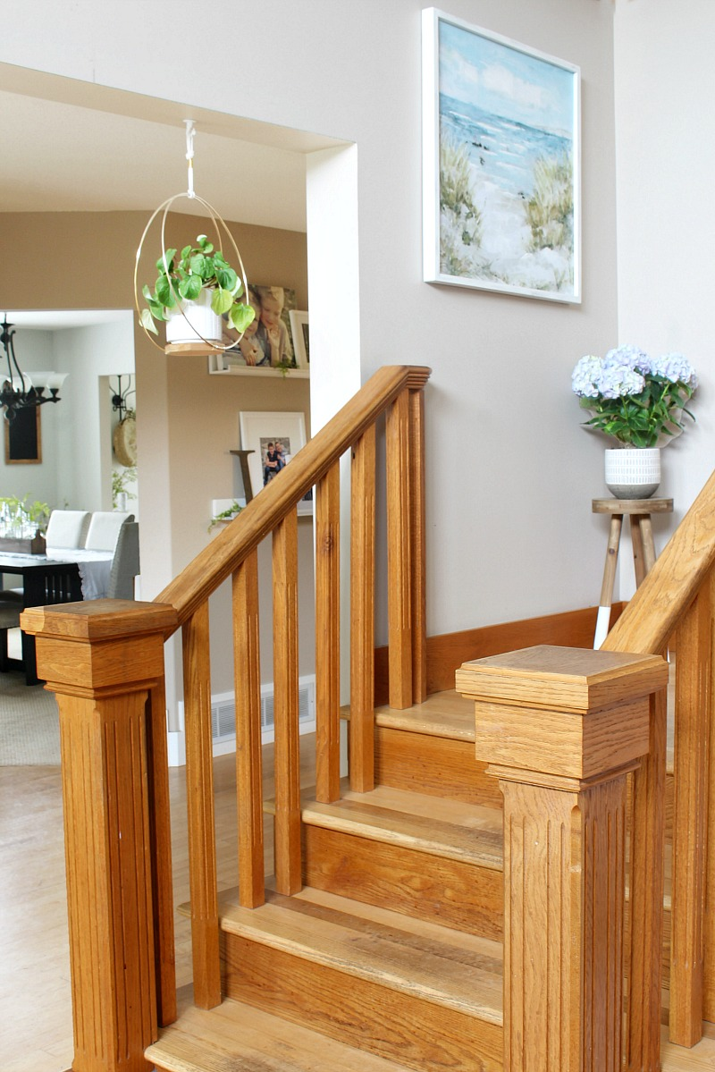 Oak staircase with summer decor.