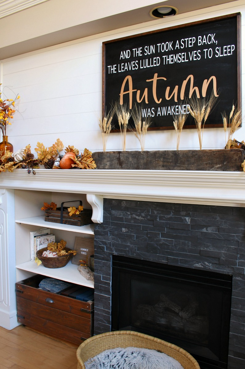 DIY fall sign hung above a fall mantel.
