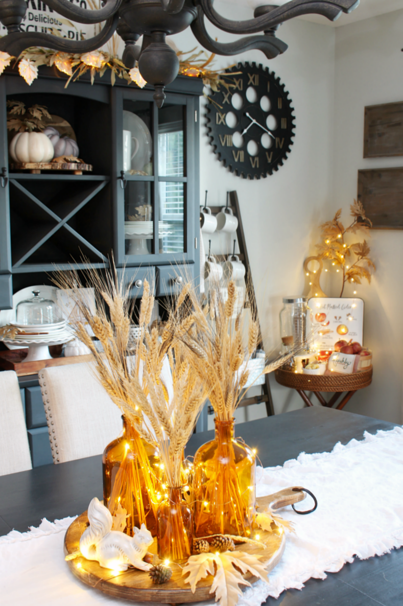 Beautiful fall dining room decorated with neutral fall colors.