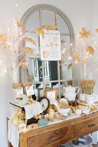 Pretty fall hot beverage bar decorated in muted fall colors.