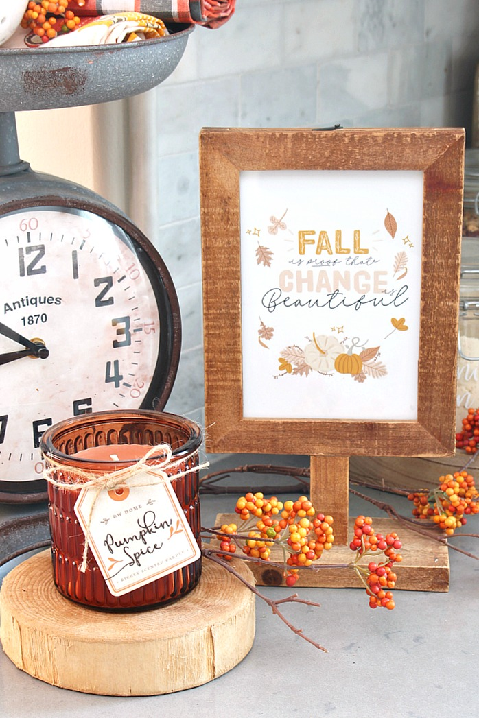 Fall Is Proof That Change is Beautiful free fall printable in a wood frame.