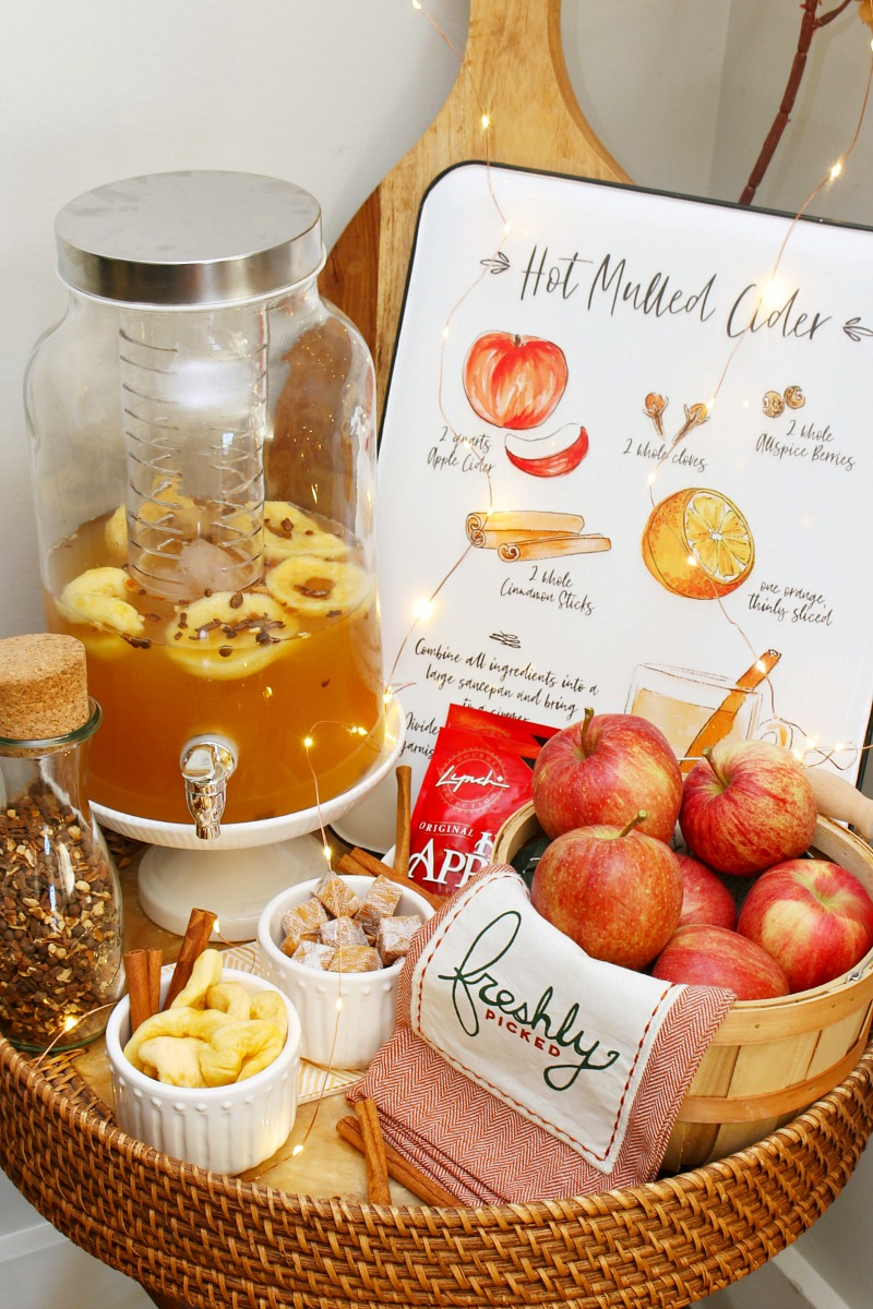 Fall dining room decor with an apple cider bar.