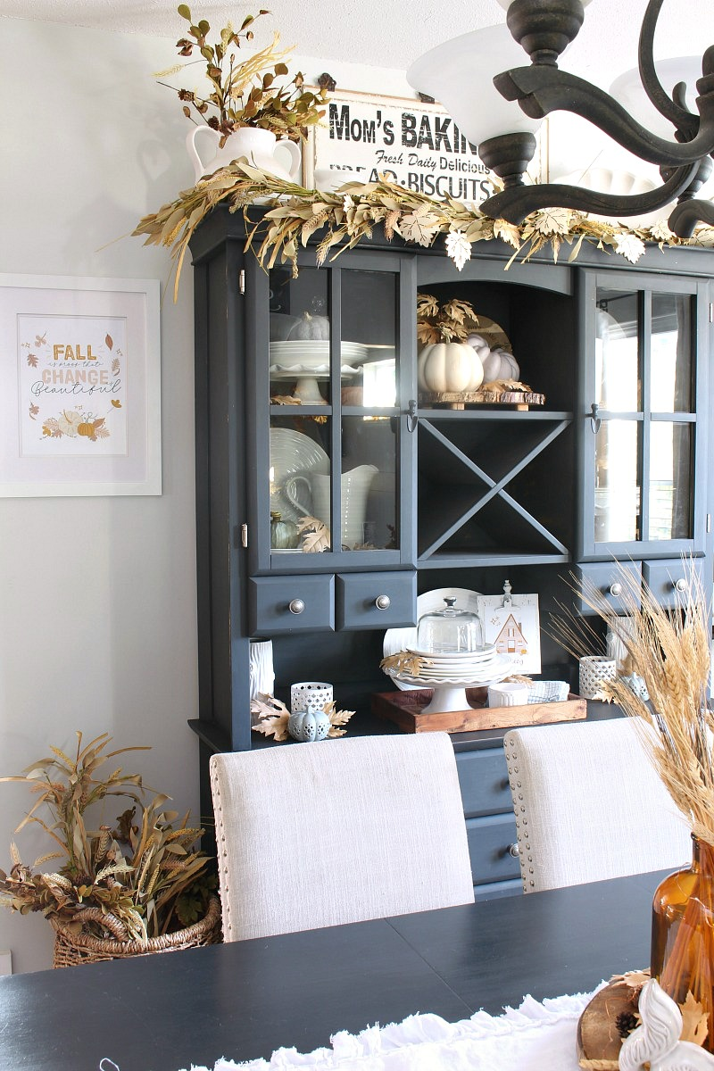 Fall dining room with Scandinavian style artwork.