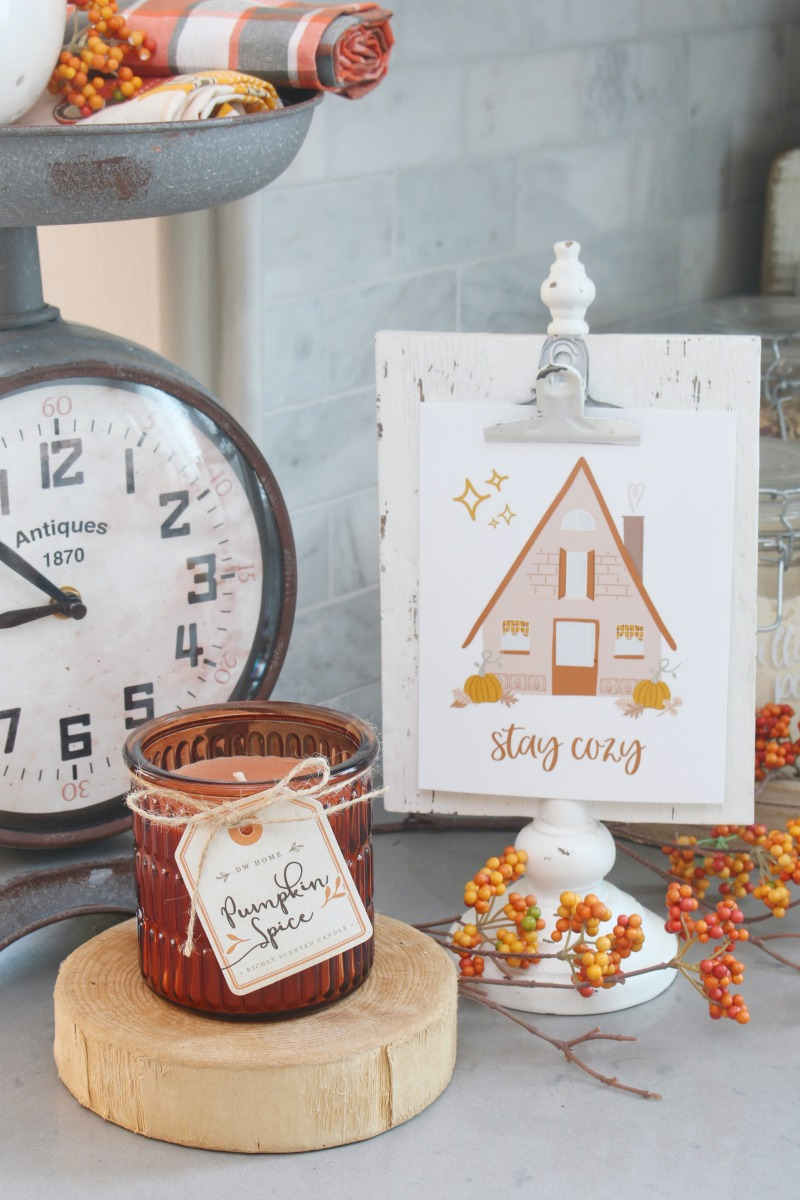 Stay Cozy free fall printables on a white clipboard photo frame.