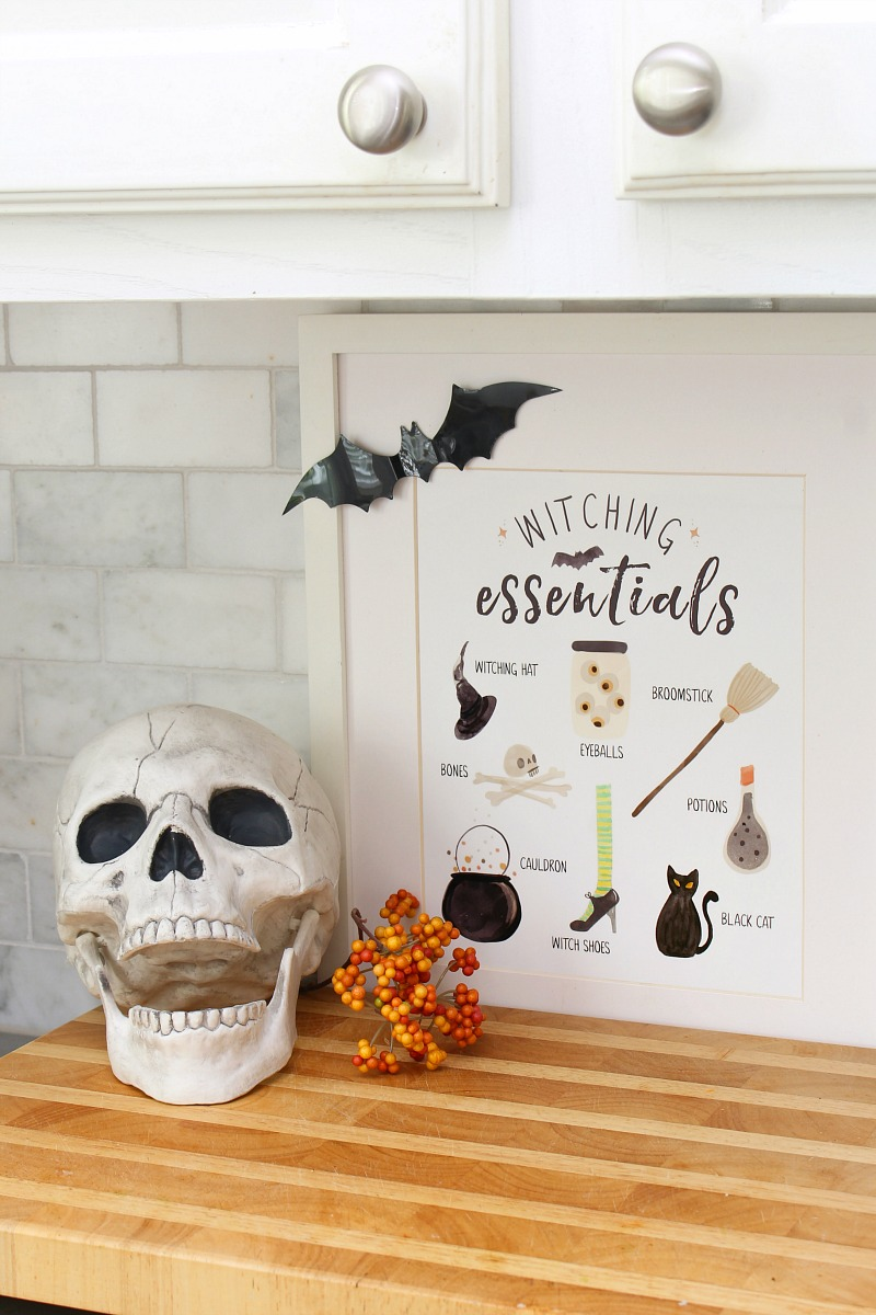 Witching Essentials free Halloween printable with skull.