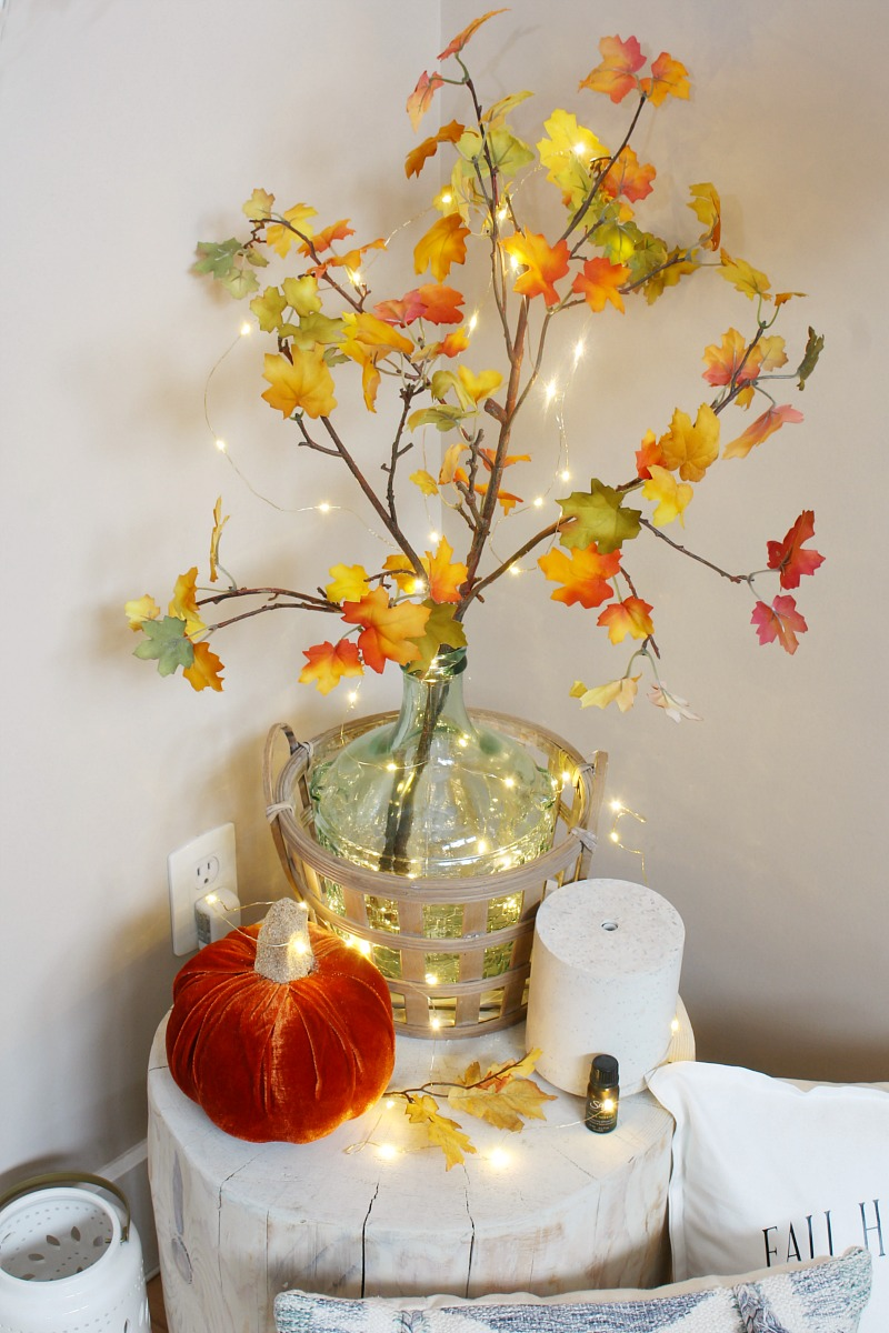 Fall vignette with faux fall stems and twinkle lights.