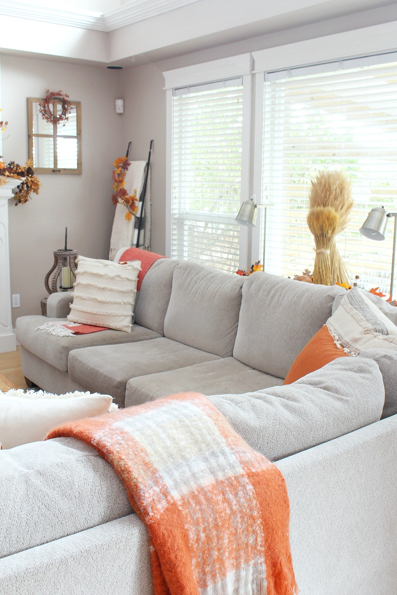 Fall living room with sectional and decorated in traditional fall colors.