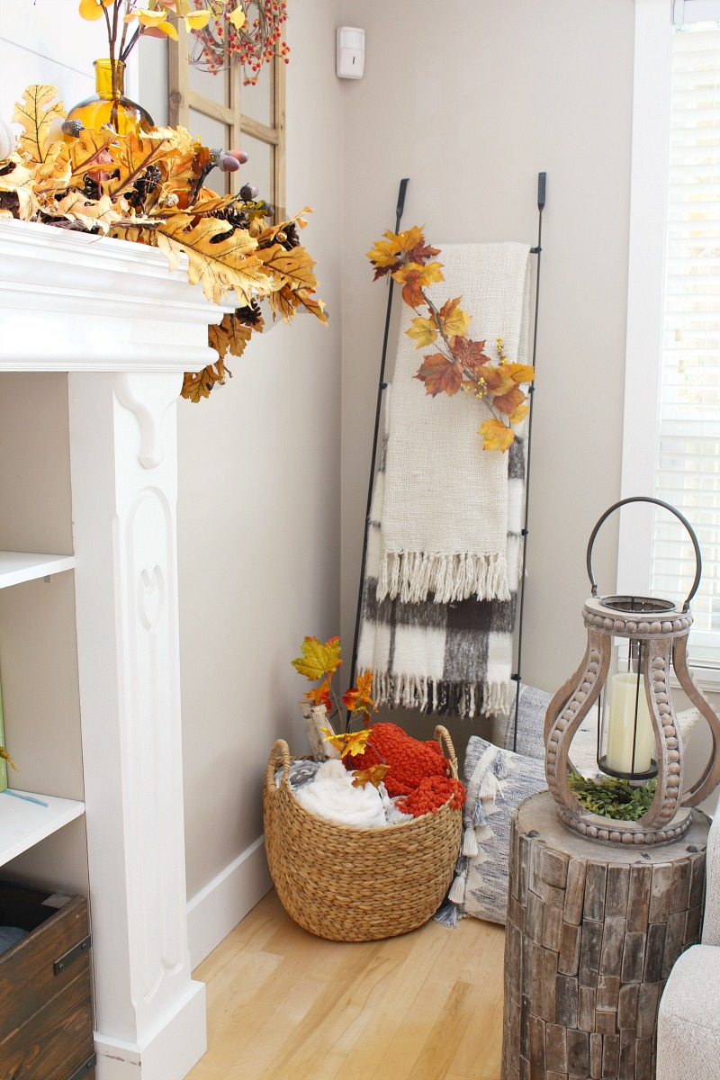Blanket ladder and basket filled with cozy blankets.