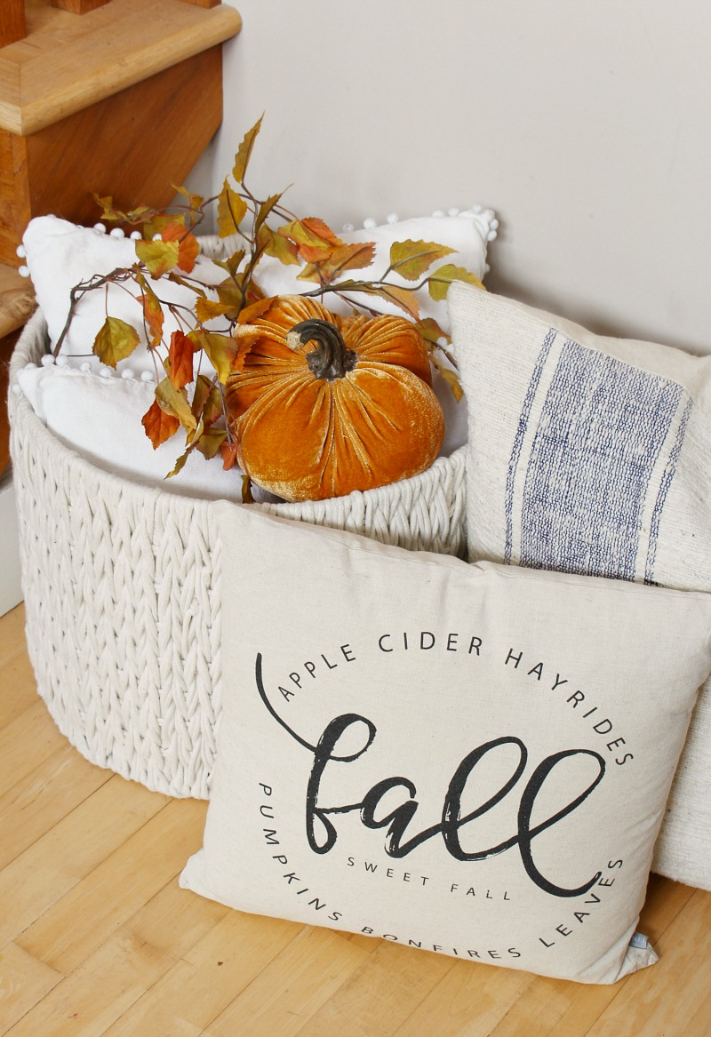 Basket of pillows in a fall display.