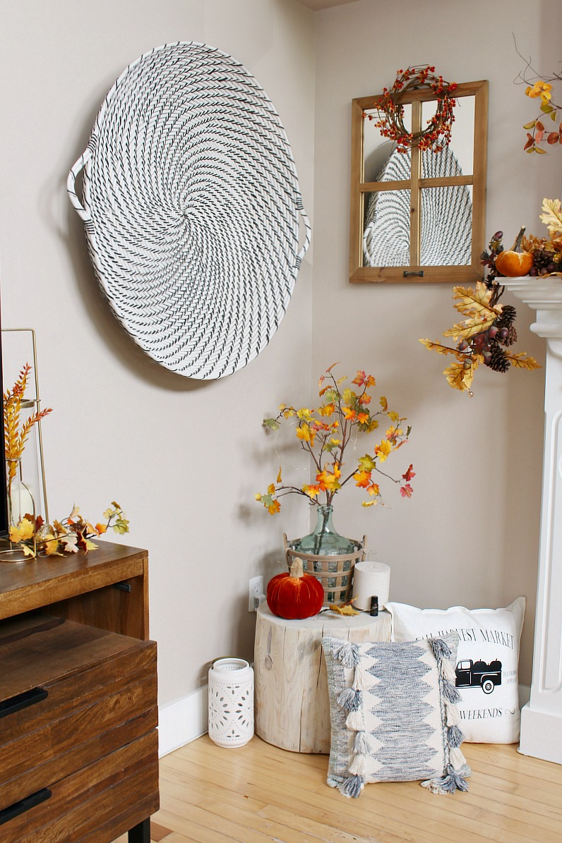 Fall vignette in the corner of a cozy living room space.