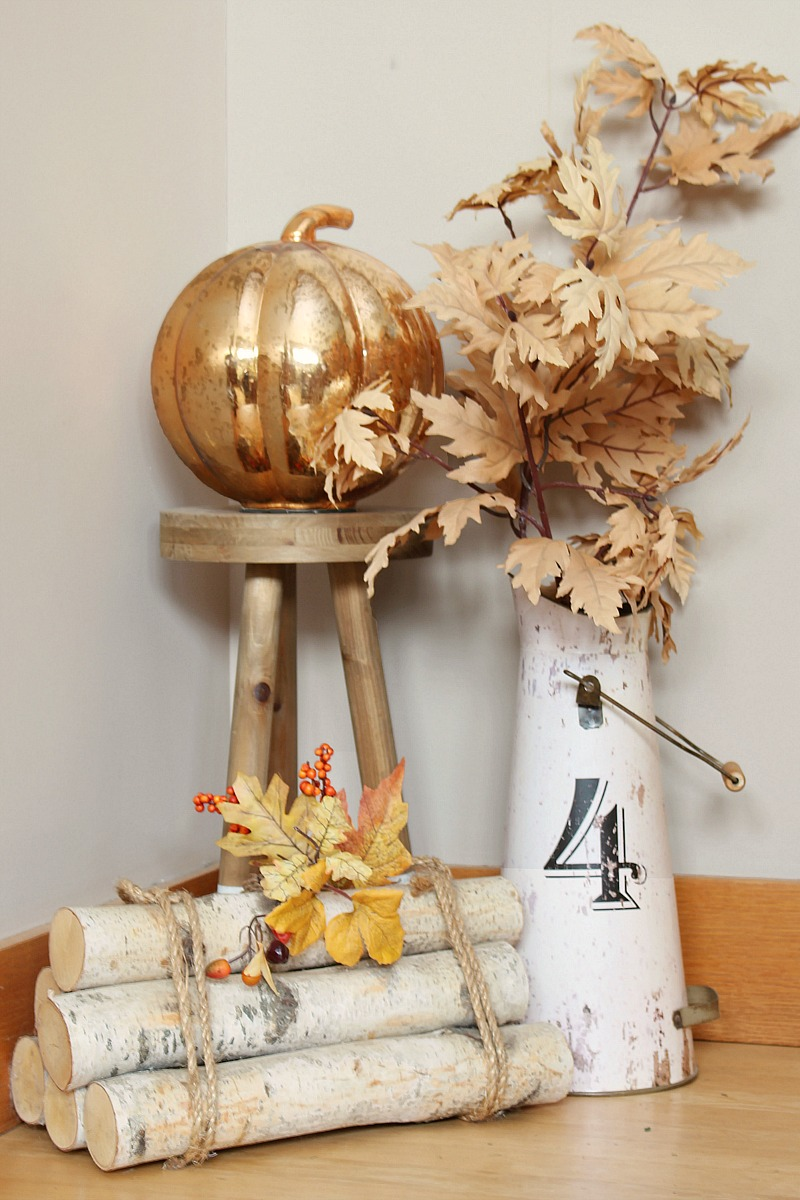 Fall vignette with faux fall stems and a metallic pumpkin.