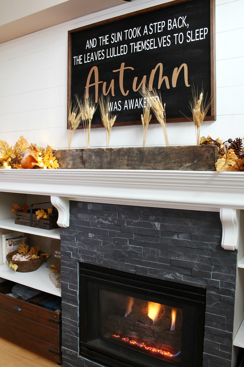 Cozy fall mantel decor ideas using traditional fall colors and lights.