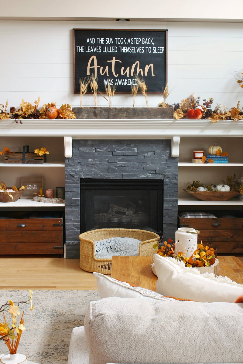 Beautiful fall mantel in a cozy living room.