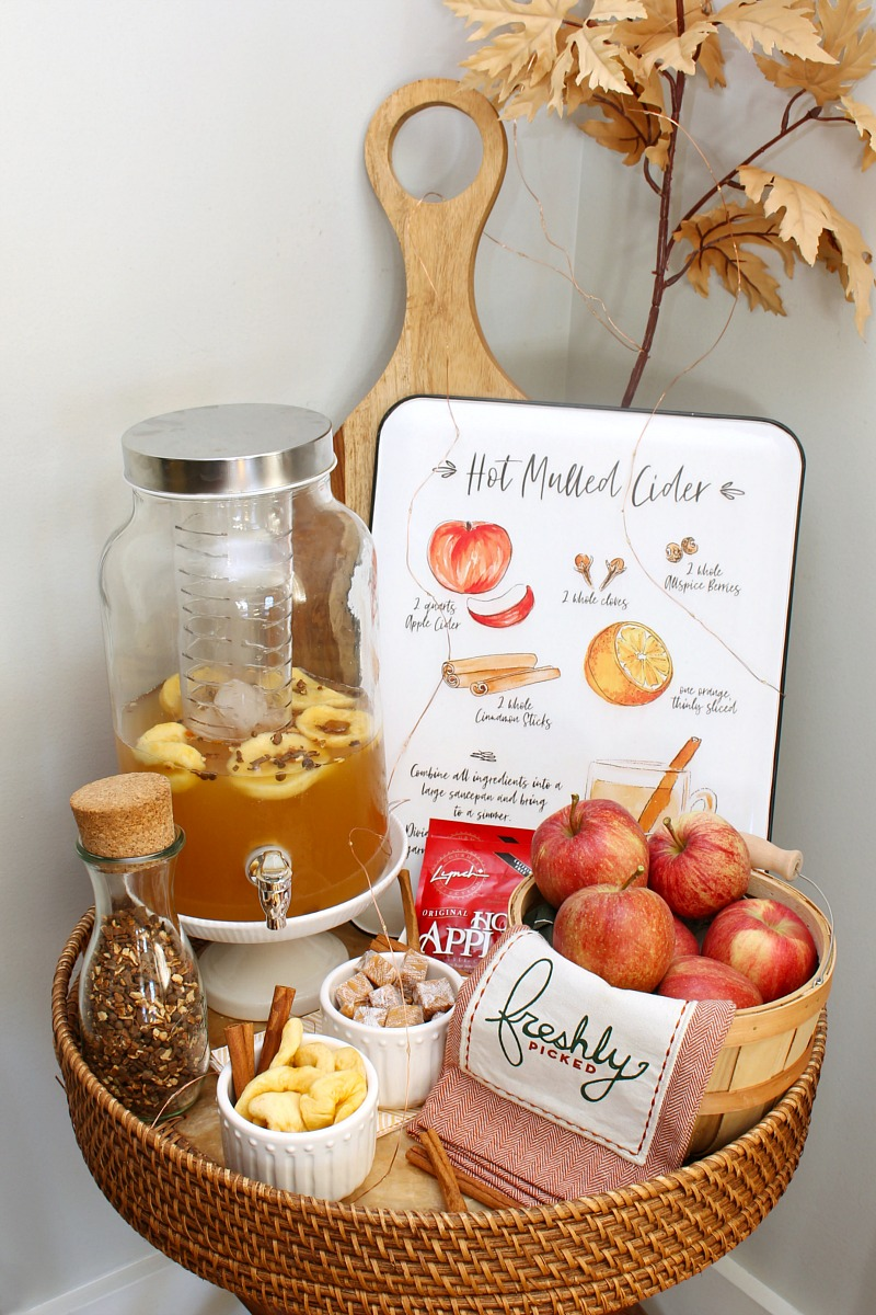 Cute apple cider bar on a small side table.