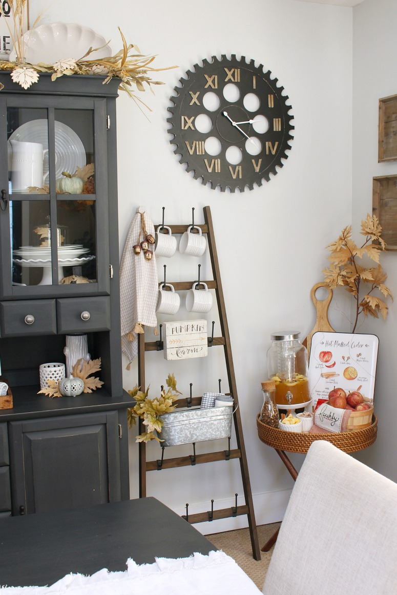 Fall dining room decor with apple cider bar.