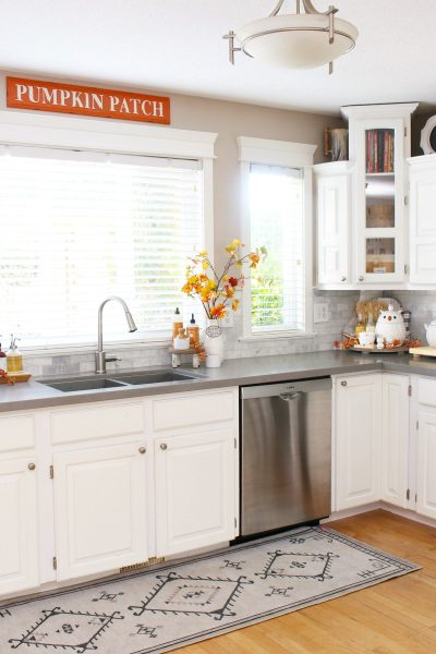 White kitchen with simple fall decor in traditional fall colors.