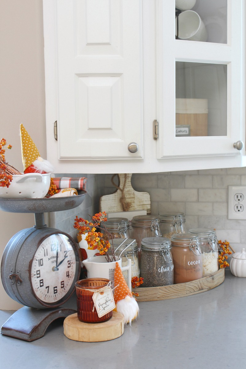 Smoothie bar decorated for fall with some faux fall stems.