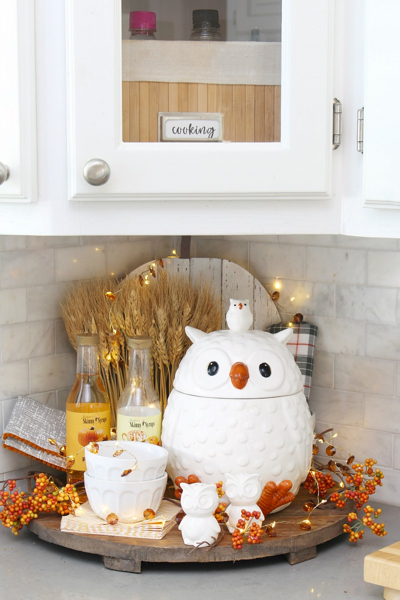 Fall vignette in a kitchen with owl cookie jar.
