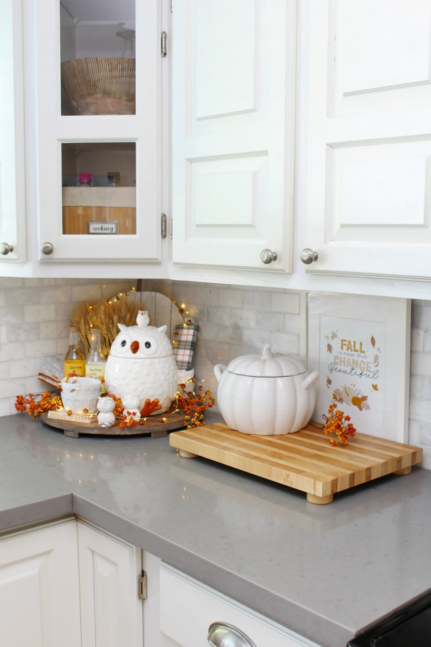 White farmhouse style kitchen dressed up for fall with seasonal colors and simple fall touches.
