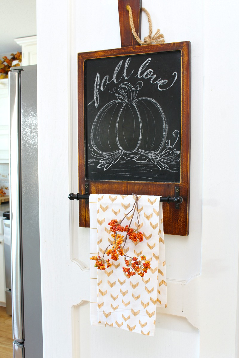 Fall love fall chalkboard with pumpkin and fall kitchen towels.