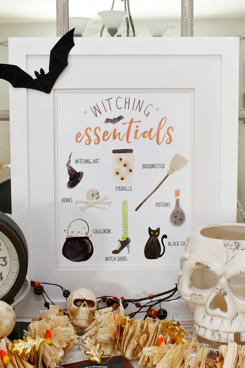 Witching Essentials free Halloween printable with Halloween decorations.