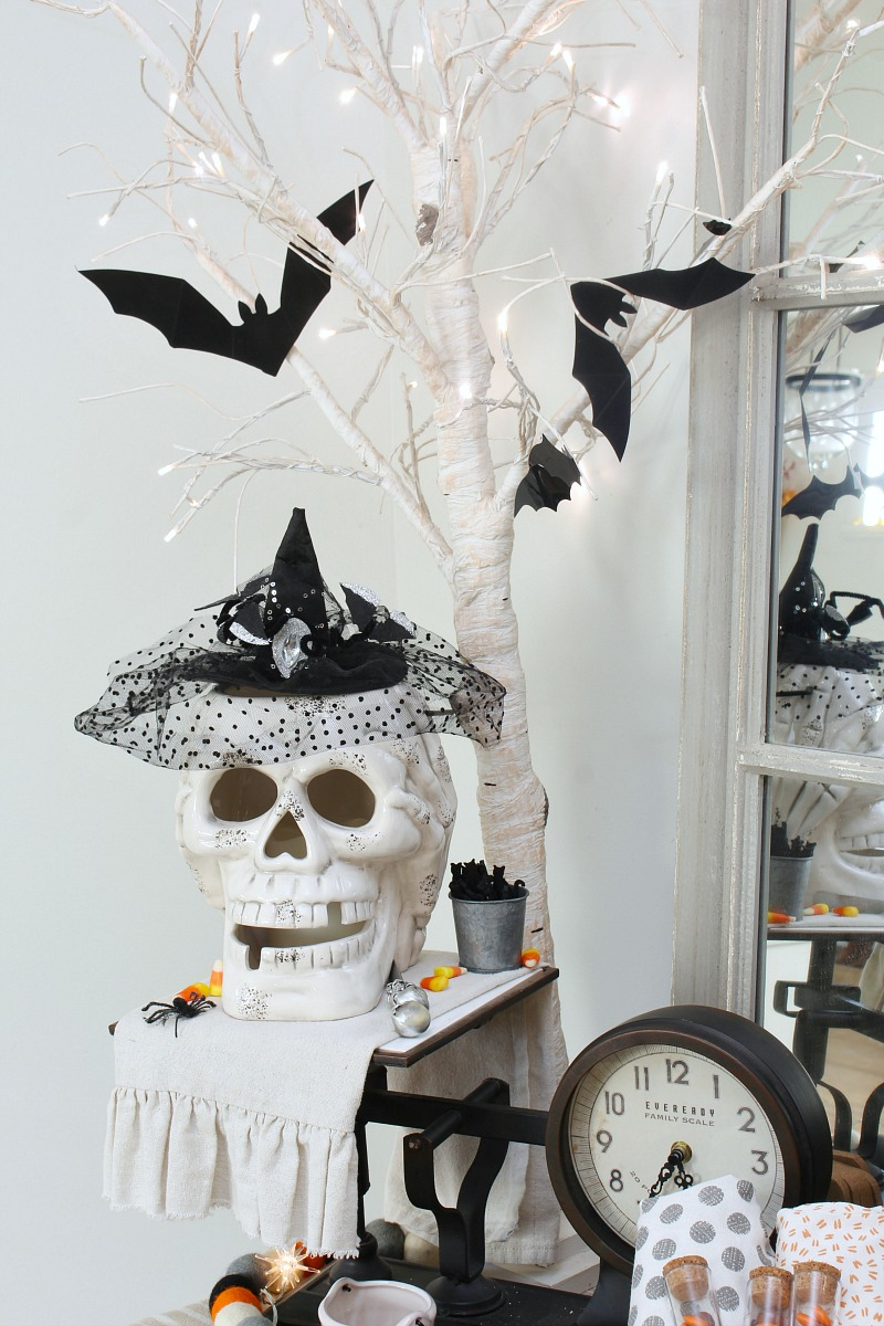 Halloween lighted skull decorated with a witch hat.