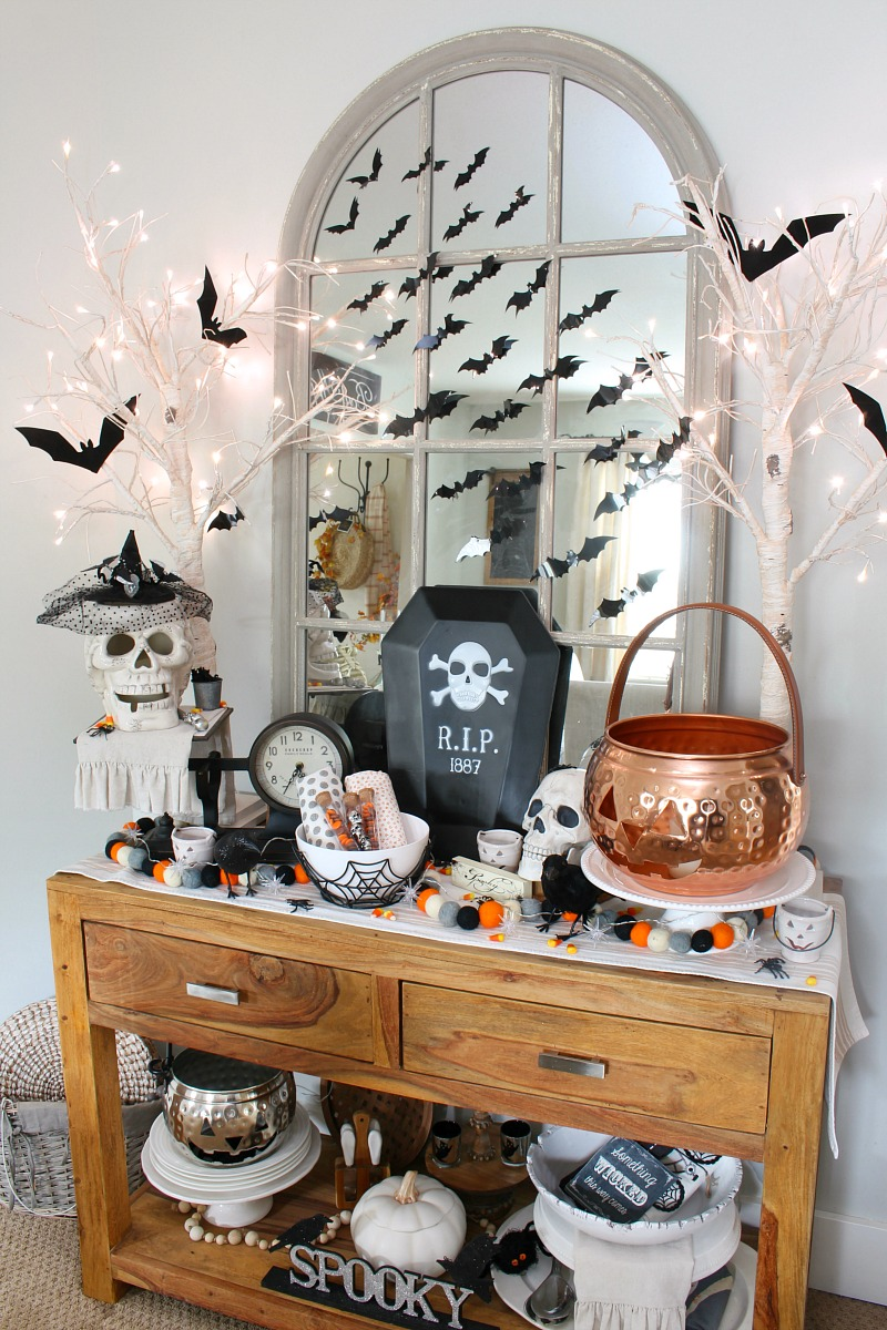 Sideboard in a dining room decorated for Halloween.