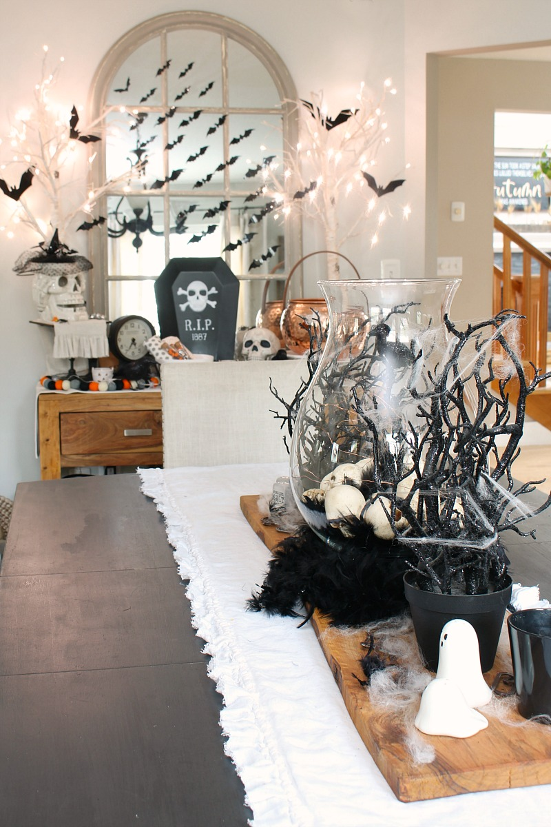 Black and white Halloween decorating ideas in a dining room.