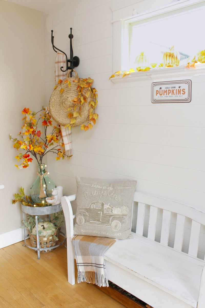 Farmhouse style foyer decorated for fall.